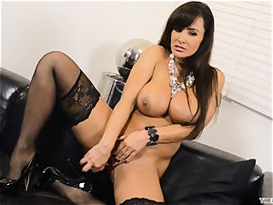 Lisa Ann thrusts her dildo deep in her raw labia