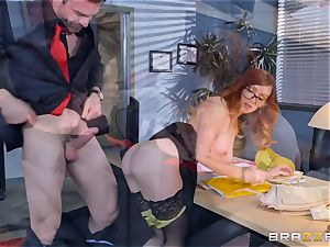 Dani Jensen playing with trunk in the office