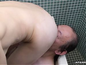 japanese super-bitch in the bathtub getting her vag eaten out