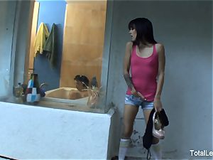 nice dark haired watches her stepsister take a tub
