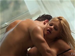 Riley Steele looks astounding as she penetrates in black lingerie