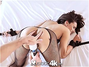 Latina Adrian Hush gets corded onto the bed in nothing but a fishnet