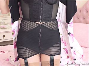 blond finger penetrates taut vagina in retro girdle nylons